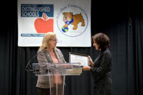 a photo of our principal receiving the award