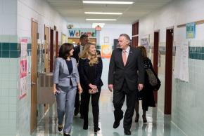 a photo of our administration walking with the governor