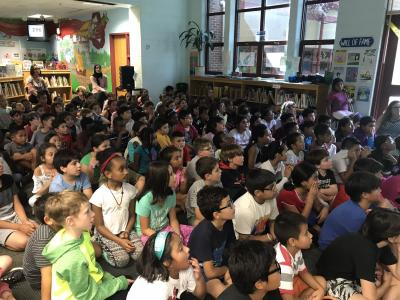 Third graders listen to a presentation from author Lauren Castillo
